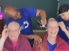Sisters have their heads shaved for cancer charity