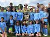 Ex-PM tells football girls to keep going like tennis star
