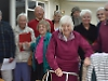 Woman welcomed home from hospital by singers