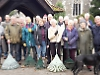 Volunteers clear fallen leaves from churchyard and green