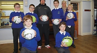 Footballs donated to school