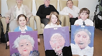 Children present portraits to care home residents