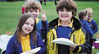 Parents join children for traditional pancake races