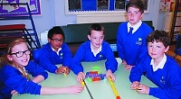 Pupils work together to solve puzzles