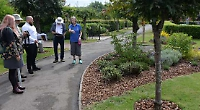 Town praised for conservation work by judges on bloom tour