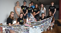 Teenagers make boat sculpture from discarded waste