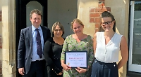 Law firm honoured by cancer charity for fund-raising