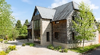 Two-storey barn with gardens designed by gold medal winner