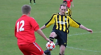 Houseman's late header puts side top of the table