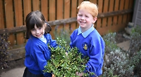 Children spruce up school garden with donated plants