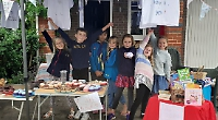 Children hold sale in aid of repairs to scout hut