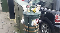 Streets strewn with rubbish as overflowing bins are unemptied