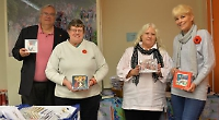 Sale of cards for charities and village's heritage trust