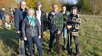 Volunteers plant 300 trees to improve meadow land