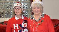 Stallholders wear Christmas jumpers for church fair