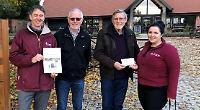 Regatta presents £3,500 to charity