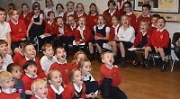 Pupils sing at school tree lights switch-on