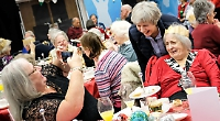 Former PM joins guests at party