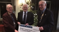Rotary club presents £1,000 to RNLI for Christmas