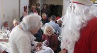 Volunteers serve Christmas Day meal to elderly
