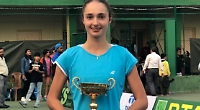 Teenager overcomes injury to lift title