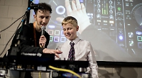 Boys learn how to make music from DJs