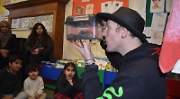 Children meet some unusual creatures at the library