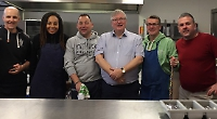 School staff cook breakfast for homeless