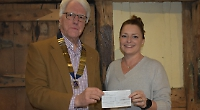 Lions present £1,000 to music school