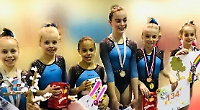 Gymnasts collect 13 medals at spring club competition