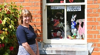 Women's storybook window displays cheer up villagers