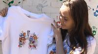Girl sells virus design T-shirts
