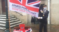 Legion chairman collects for Poppy Appeal in storms