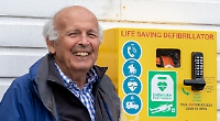 Defibrillator fitted at boating club thanks to jazz fans