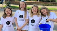 Girls sell old toys, clothes and books for cancer charity