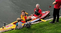 Father and son firefighters in Thames charity paddle