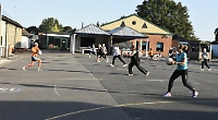 Women walking back to happiness on netball court