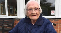 Woman surprised by singing family on 100th birthday