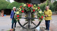 Flower ladies use old well to create special displays