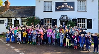 Father leads children's walk in aid of his cancer treatment