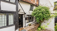 Listed town centre cottage that was built in 15th century has period features