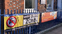 Anti-air pollution campaign banner torn down again