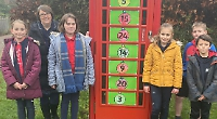 Old phone box turned into advent calendar by children