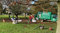 Volunteers clear leaves from green and churchyard