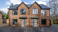 Heritage brickwork and natural slate roof shows close attention to detail