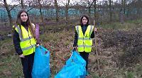 Volunteers clear streets of growing rubbish piles