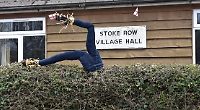 Families create scarecrow trail for school