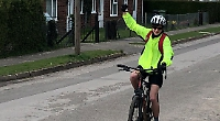 Cyclist rides equivalent of length of country for charity