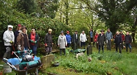 Rector joins volunteers to tidy up overgrown churchyard
