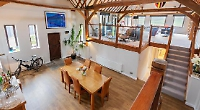 Four-bedroom converted barn with gardens on three sides and panoramic views